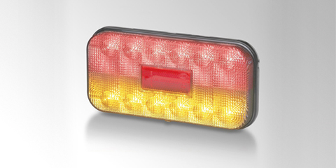 Full LED rear combination lamp for agricultural and construction vehicles, amber/red, rectangular, from HELLA.
