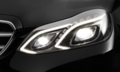 First vehicle with 100% LED low beam headlamps and optional camera based full-LED headlamp with glare-free high beam